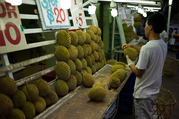 If the spiny exterior weren't warning enough, the durian has a less than appealing odor. This stall in Singapore has many to choose from.