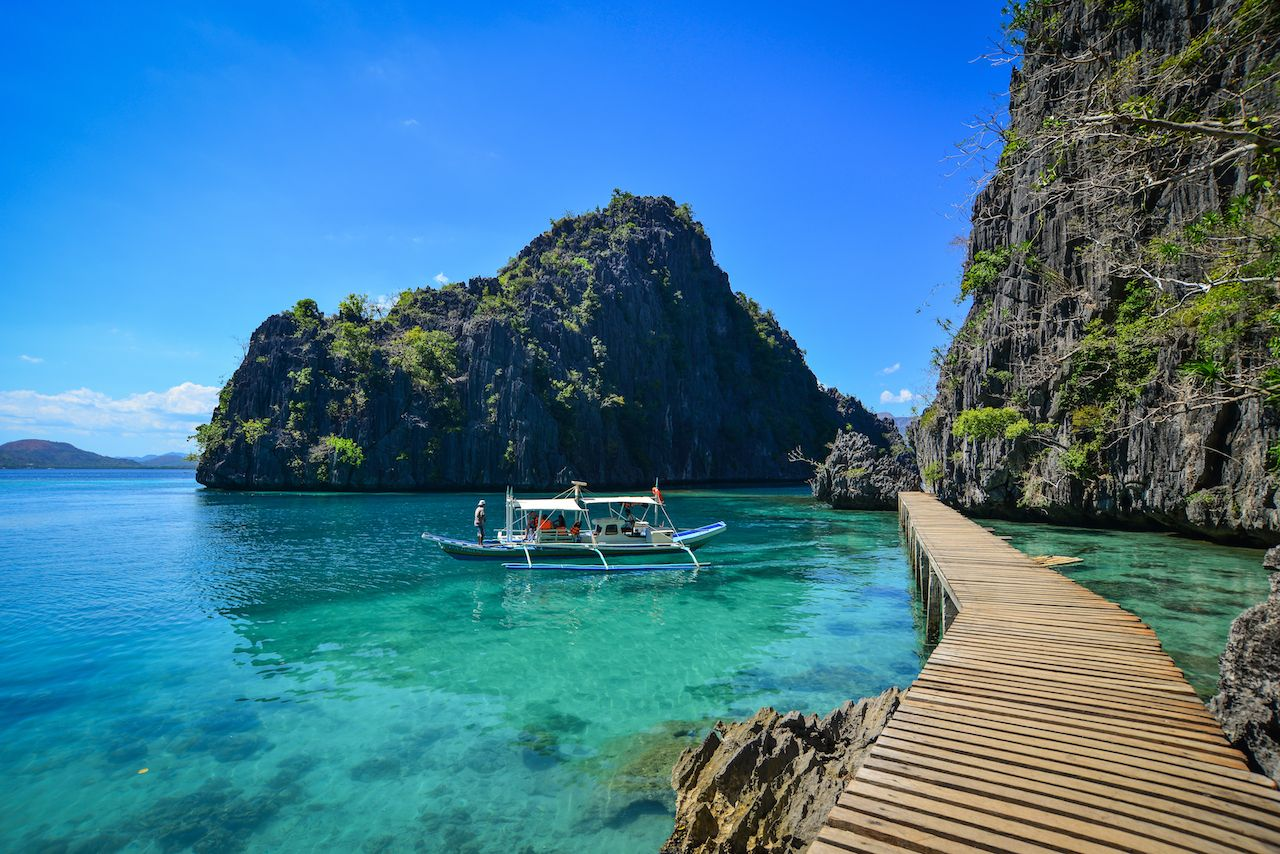 turquoise water with boat in the philippines