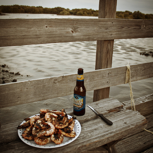 Enjoying Peel n' Eat Shrimp and Beer on the Dock