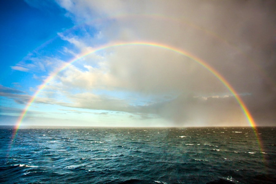 A rainbow over the water