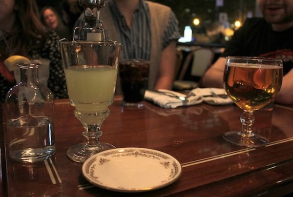 An absinthe drink on the bar at Dominion Square Tavern
