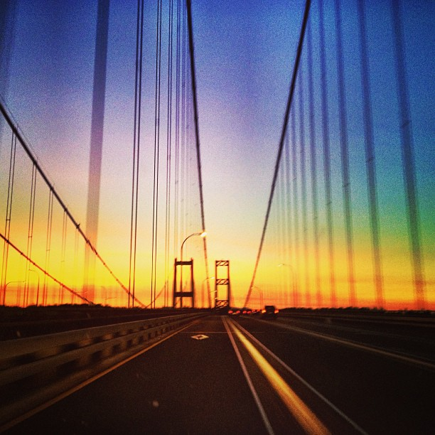 Bright sunset colors through bridge cables