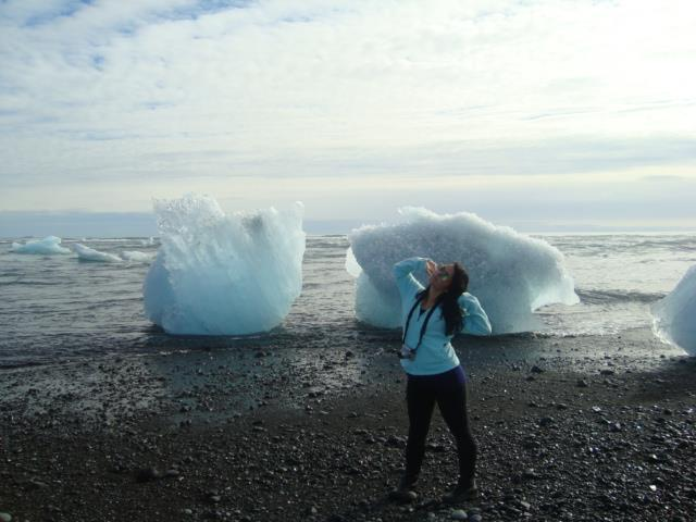 Katka poses in front of iceberg pieces