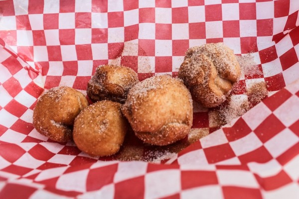 Fried balls of butter in a checkered food wrapper