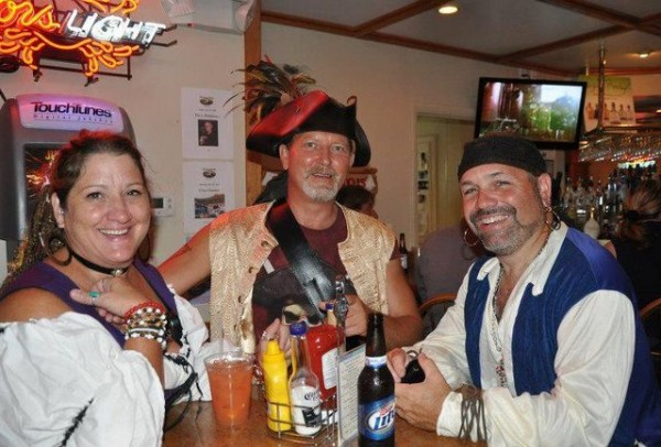 People dressed as pirates in a bar