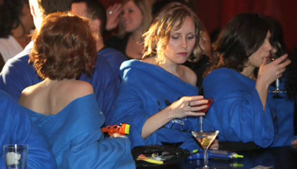 People wearing Snuggies in a bar