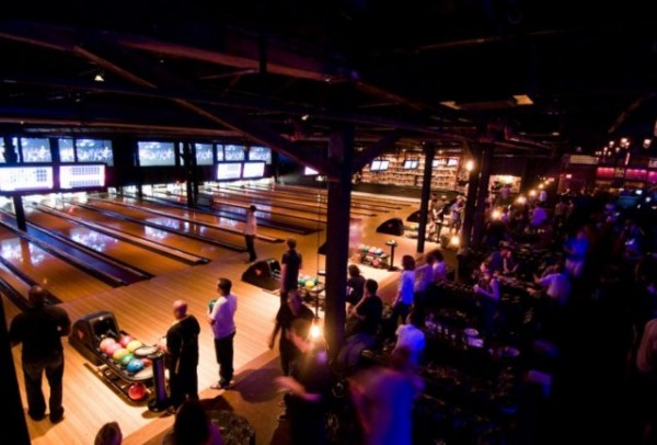 People bowling and onlooking at Brooklyn Bowl