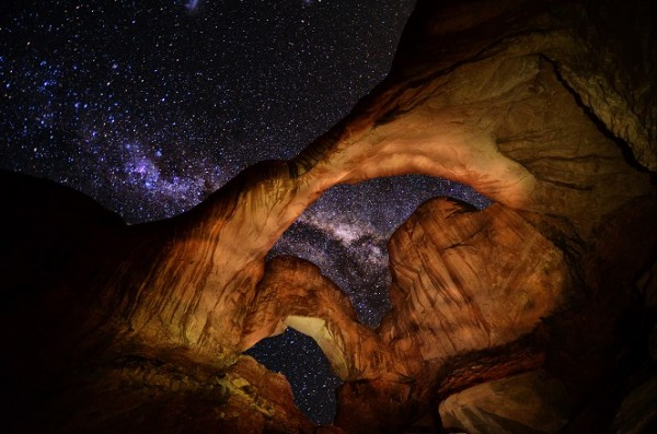 Stars above a stone arch in Arches National Park