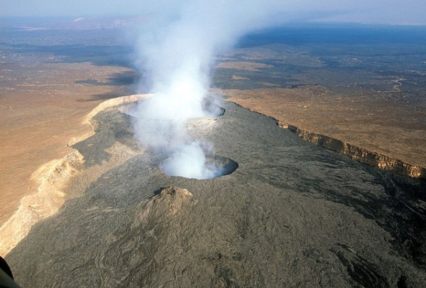 An aerial view of a smoking volcano