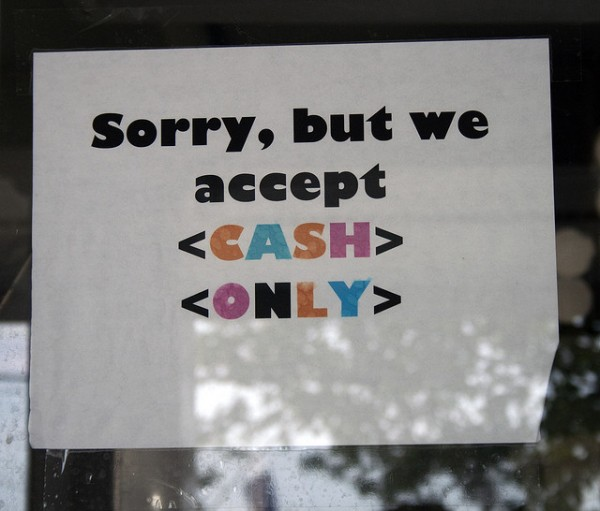 "A sign that says ""Sorry, but we only accept cash"""