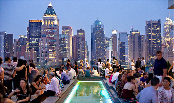 A rooftop bar with lots of people