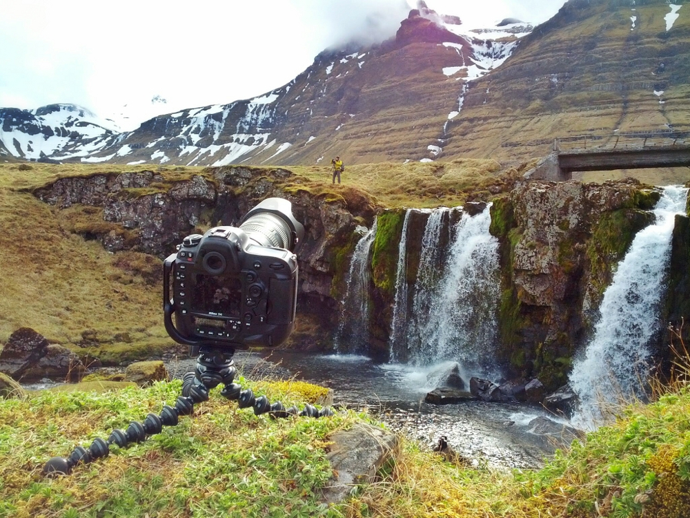 Photographer and waterfall