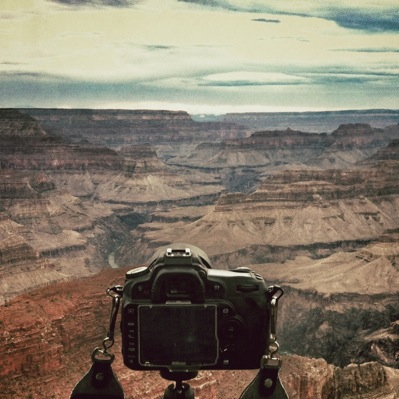 Camera with canyon in the background