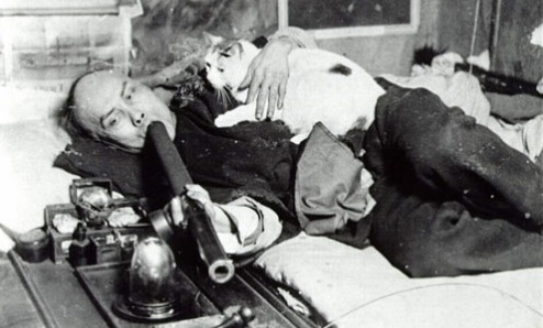 A man smoking opium with his cat