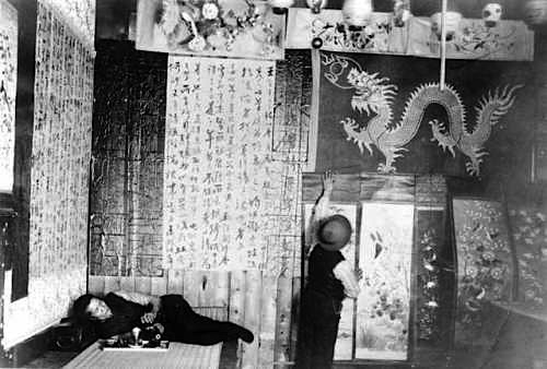 Scrolls hanging on the walls of an opium den
