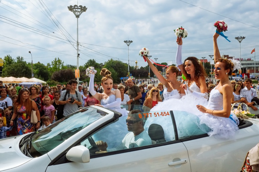 Brides with arms raised