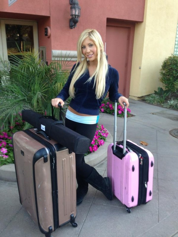Tasha with her suitcases