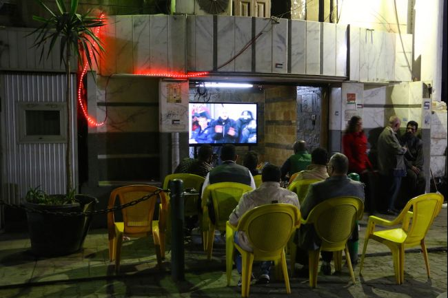 Patrons watch football at an ahwa near the Cairo stock exchange, or the Borsa. (Laura Dean/GlobalPost)