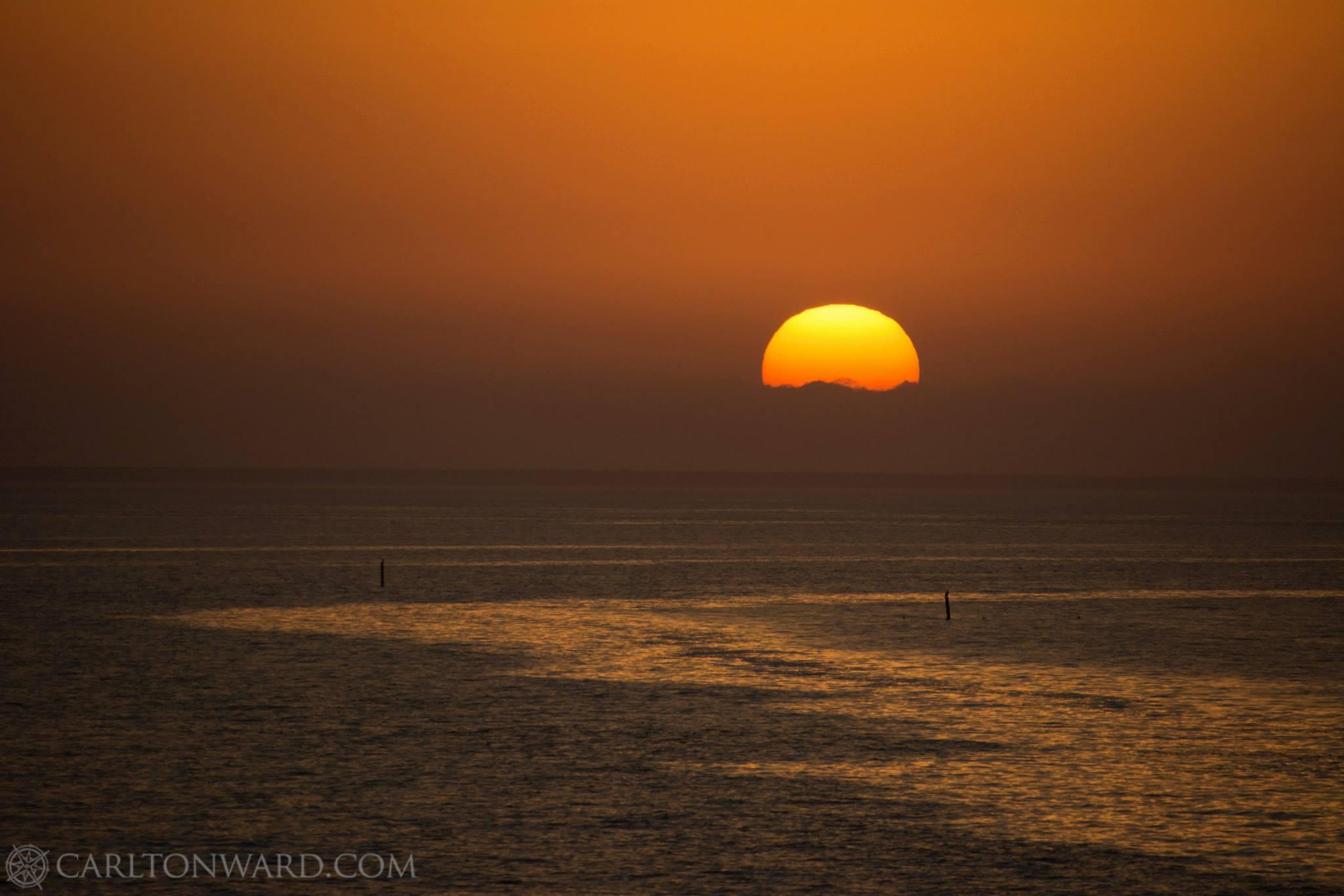 Photo: Carlton Ward The sun sets over Apalachicola Bay.