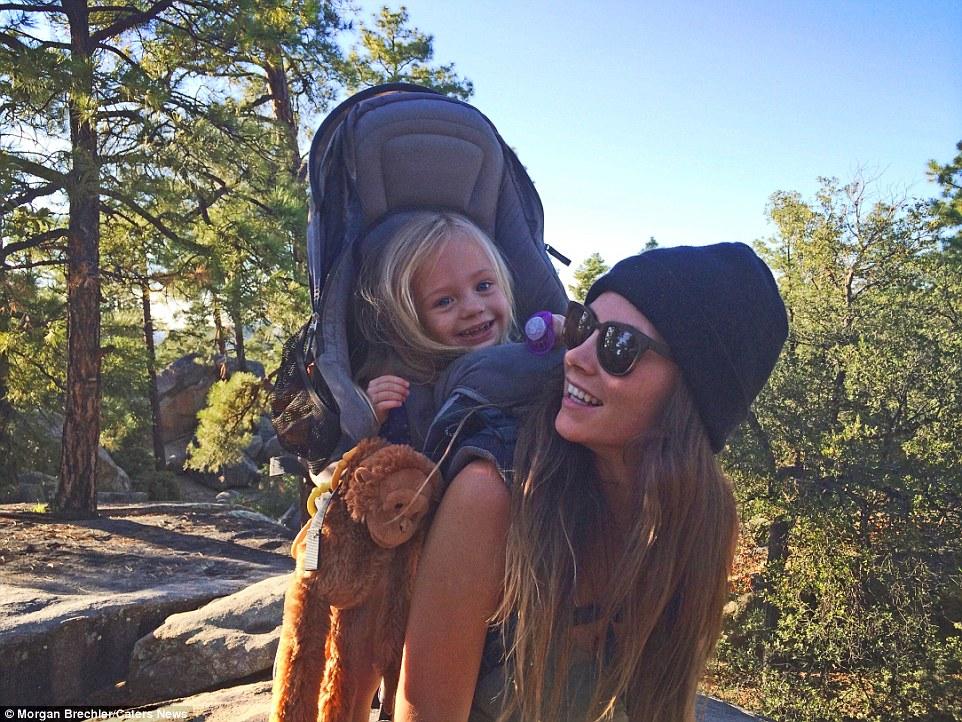 Adventurous toddler treks America's national parks on her mama's back
