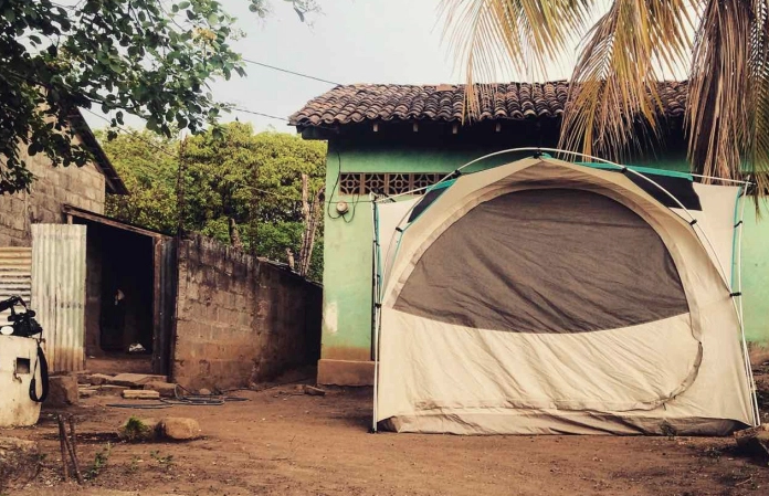 Caption: In Nicaragua, a slice of pizza sometimes comes with a safe place to tent up for the night. Global Goulets