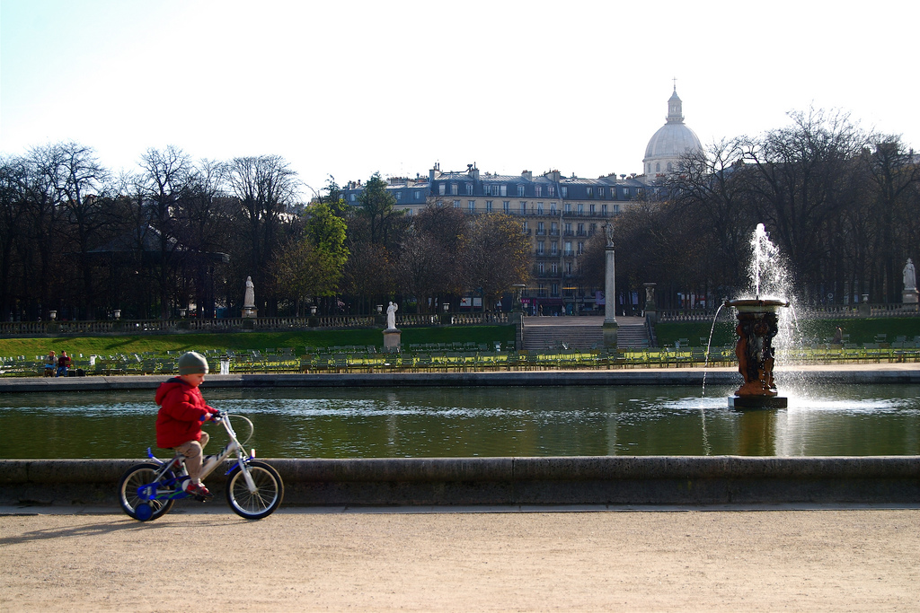 child biking in Paris