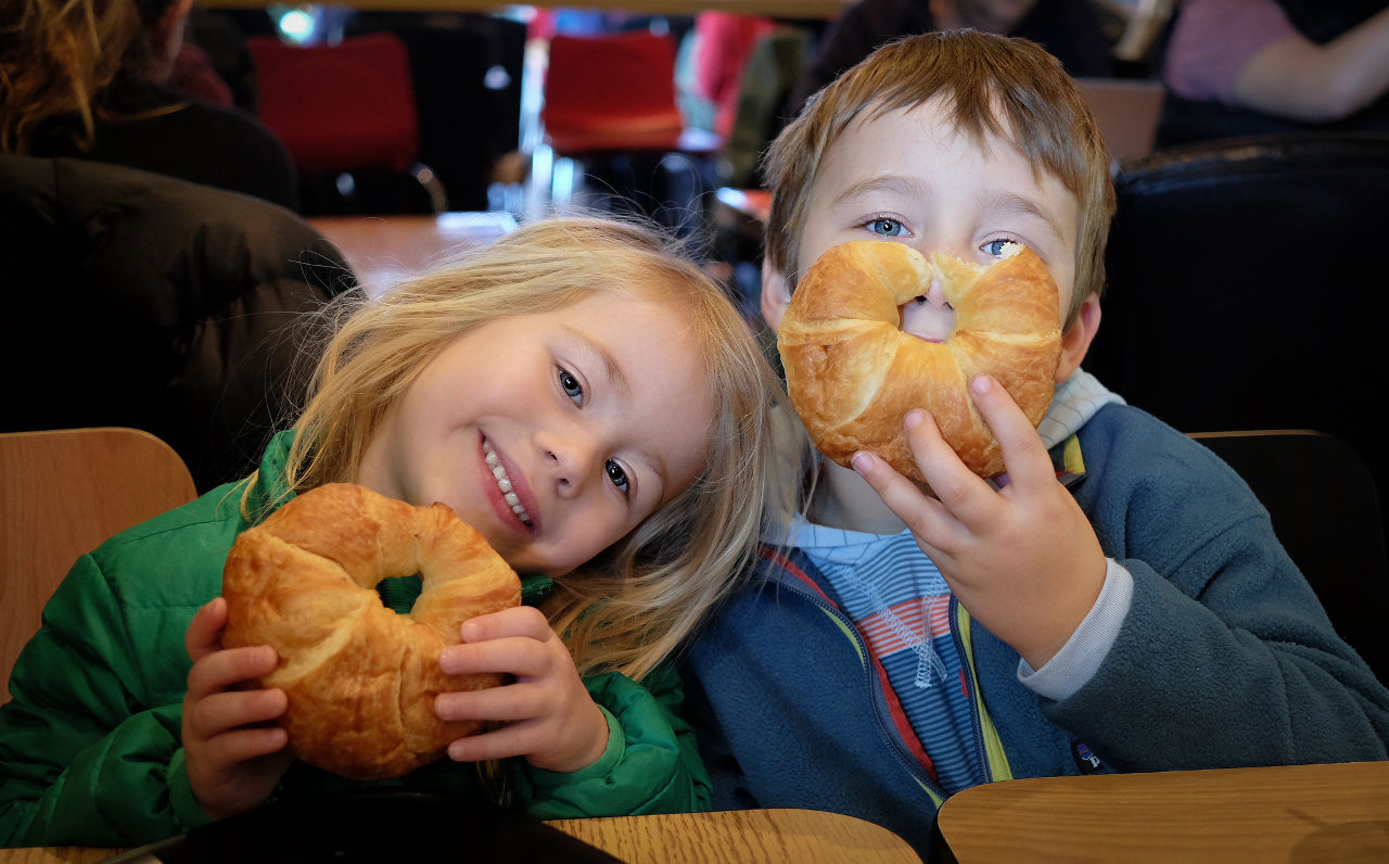 Children eating croissants