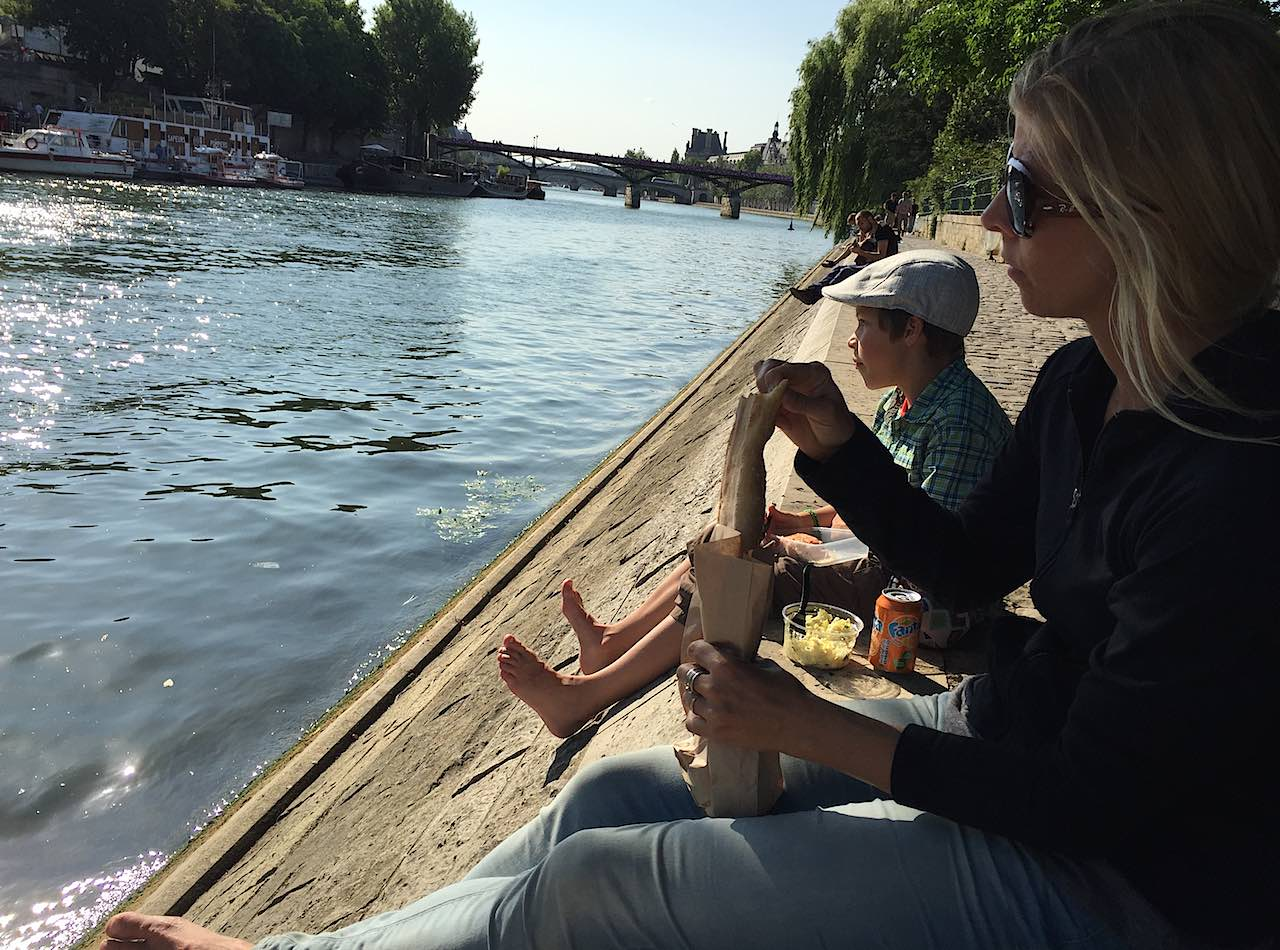 Family picnic by the Seine