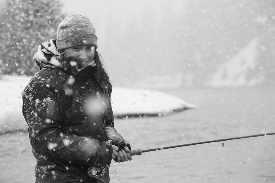 Women fishing in snow fake
