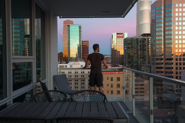 The photographer looks over the sunrise colors of the city from his room at Level Furnished Living. Level provides short stay apartments, meaning you can't stay there long enough to move in and you can't stay short enough to treat it like a hotel. As a new, booming creative class moves into the city, this style of living has become increasingly popular for those who want to avoid a lease.