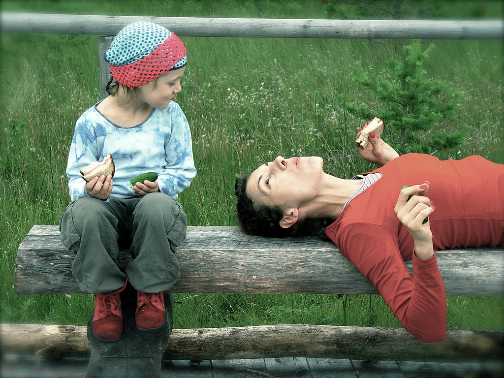 woman-daughter-eating-outside