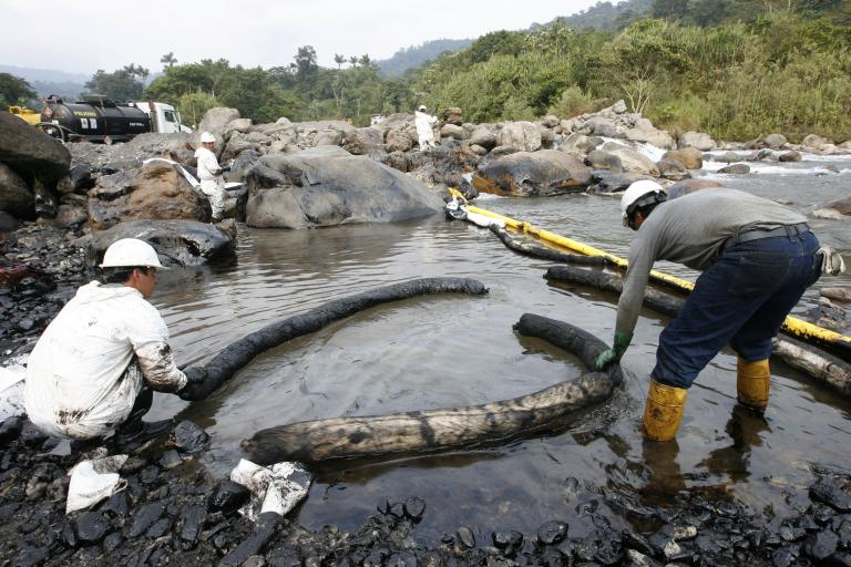 Photo: Workers clean an oil spill on the Santa Rosa river in 2009. Ecuador's second largest oil pipeline ruptured in the lush Amazon jungle, shutting off the flow of crude to a Pacific port.  Kamilia Lahrichi/GlobalPost