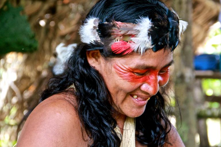 "Photo: ​Kyenyé, Ngaya Nenkimo's first wife. Red face paint marks her as a ""friend of the forest."" Living in harmony with nature is crucial for this animist tribe.  Kamilia Lahrichi/GlobalPost"