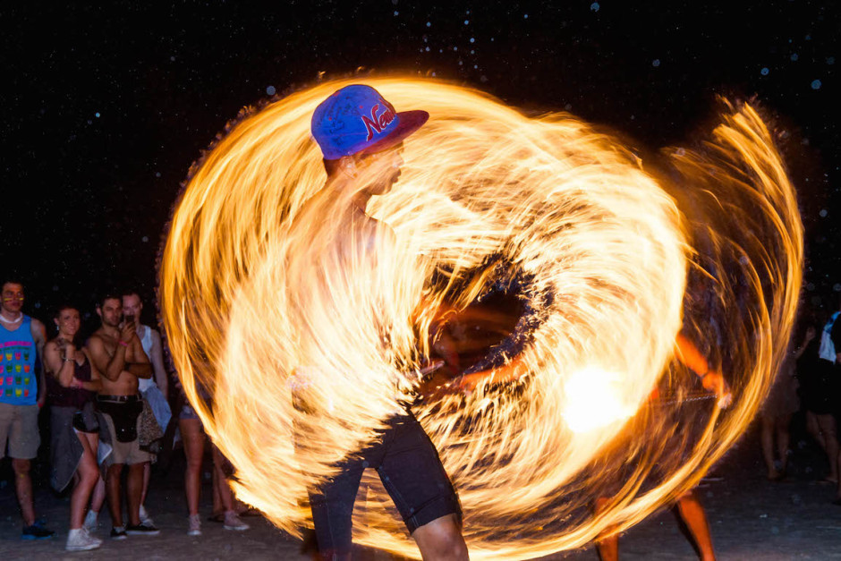 Photo: A fire spinner on the beach in Thailand.
