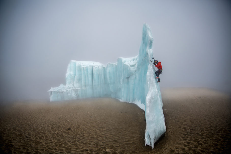 Will Gadd ice climbing near the summit at 19,000 feet on the glacier ice on Mount Kilimanjaro, Tanzania, Africa.