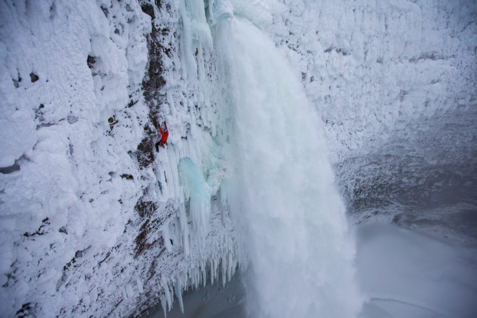 Will Gadd climbing the first ascent on a mixed route, Overhead Hazard at Helmcken Falls in Wells Gray Provincial Park, BC, Canada.