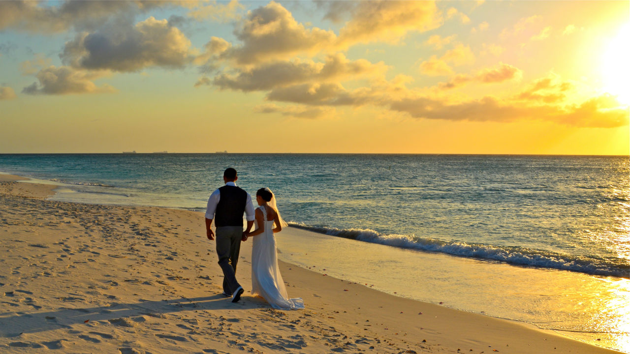 Wedding Couple Walking on Eagle Beach at Sunset 3