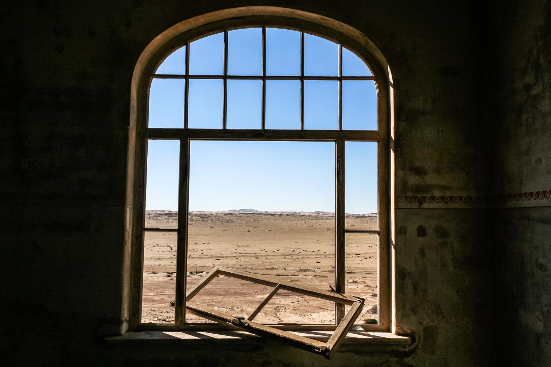 Kolmanskop's houses are a part of the surrounding desert