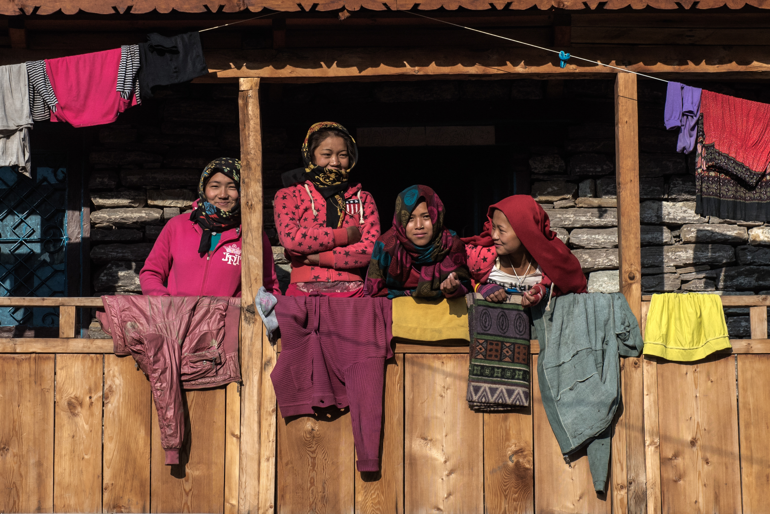 Young women rest before work in the early morning - Samagaon Village.