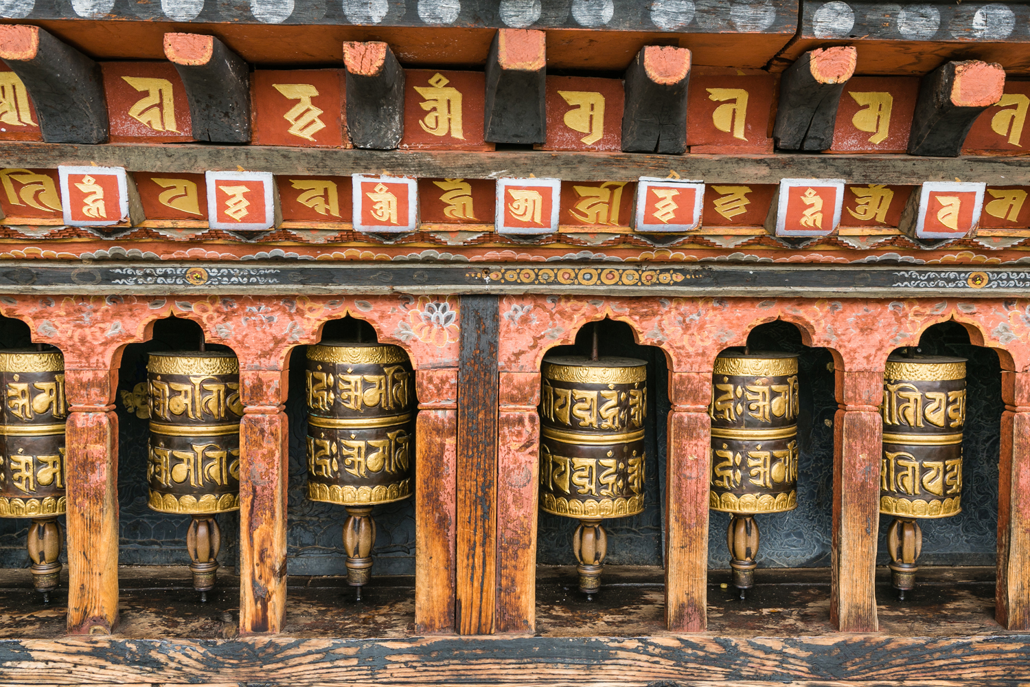 A row of prayer wheels in Thimphu
