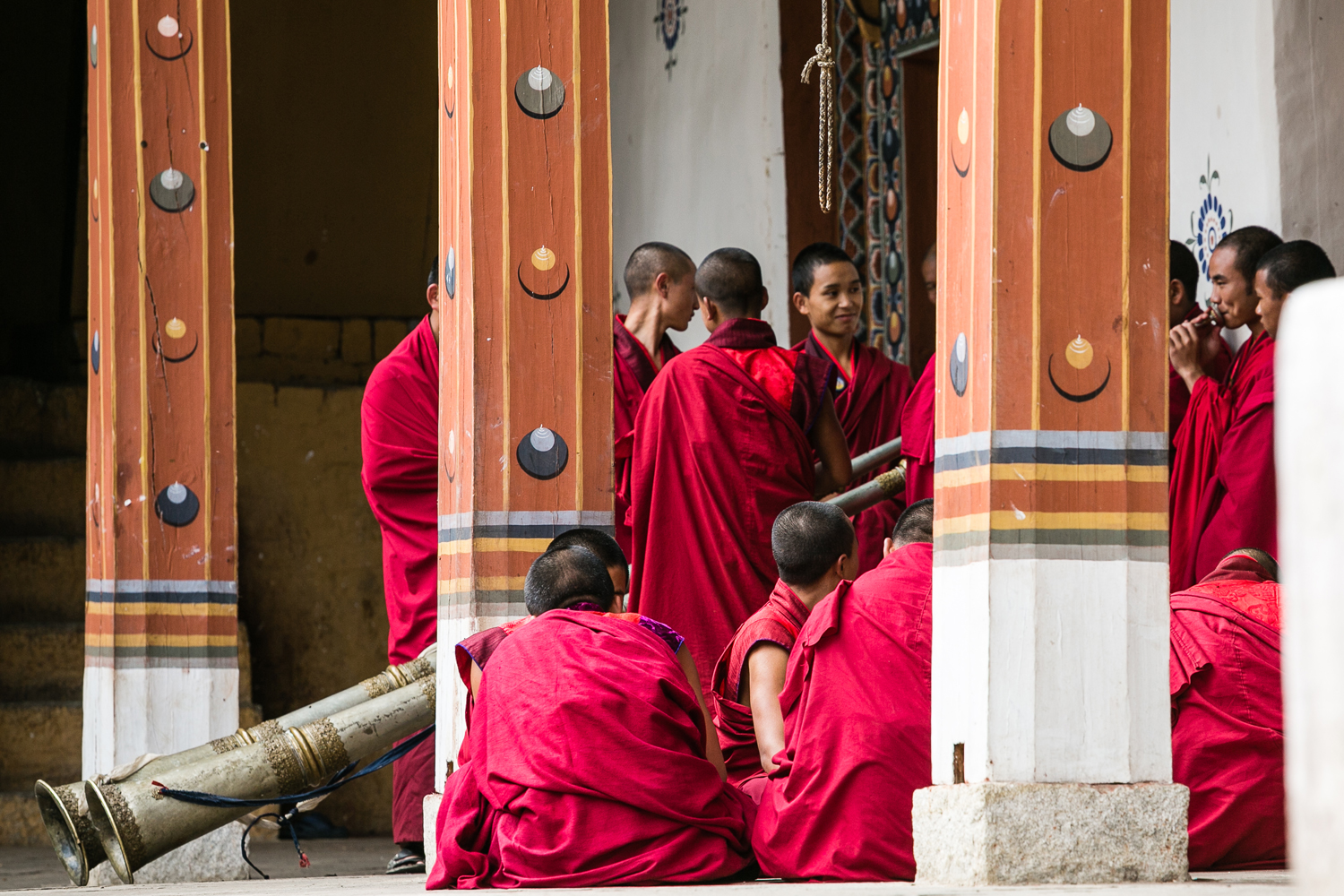 Young monks play dungchen (Tibetan horn) in Thimphu Dzong