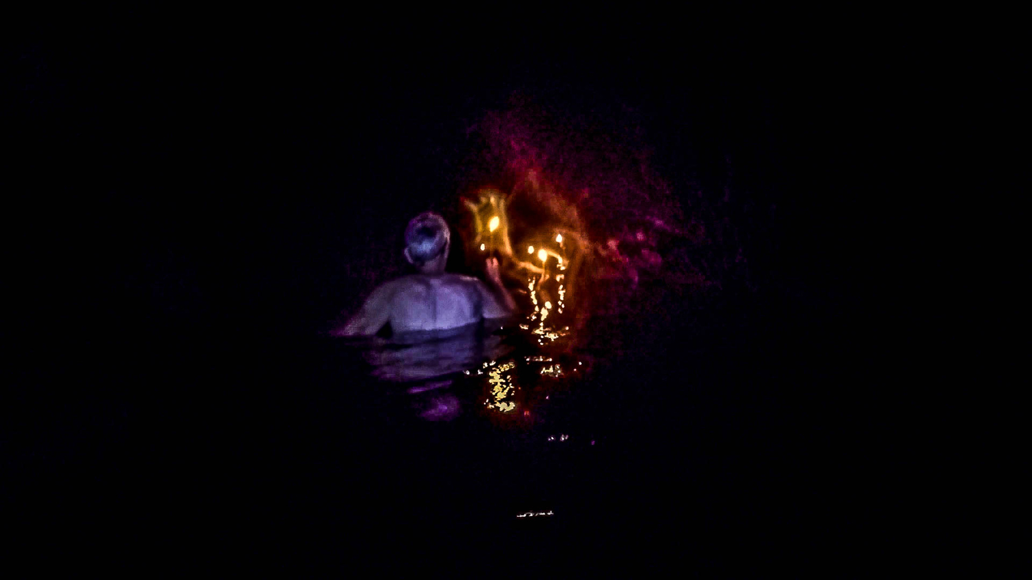 Brave 63 year old takes his daughter caving. Swimming while holding a candle is no easy task!