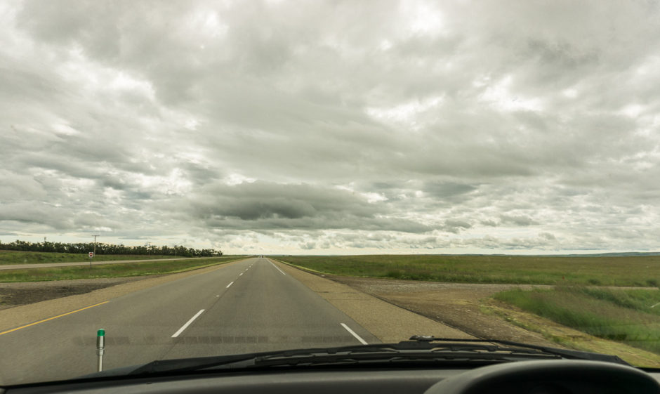The Canadian prairies, long and straight roads, and awesome skies. Photo by author.