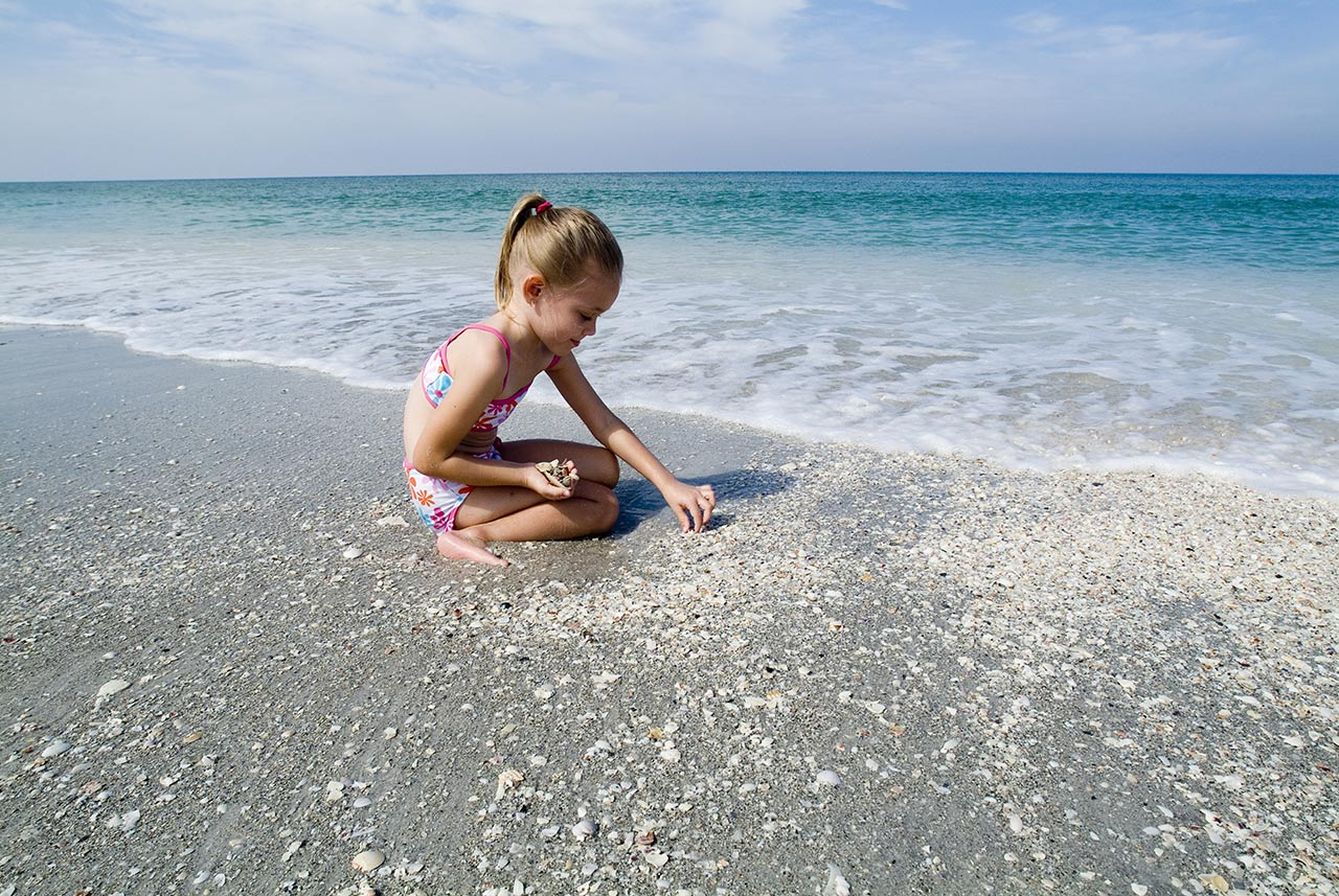 Girl shelling Florida beach