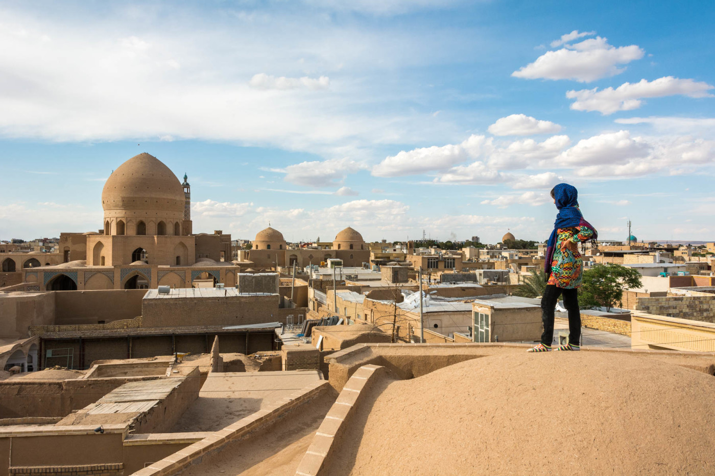"""Rocking the demure Iranian ladydress (more formally known as a """"manteau"""") on the rooftops of Kashan."""