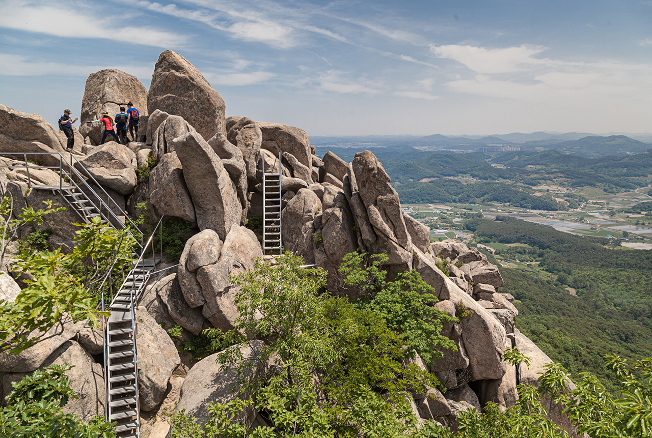 'Snakes and Ladders'. Rickety staircases are the only way to reach the top of many of South Korea's granite-topped peaks – Mount Palbong, Seosan
