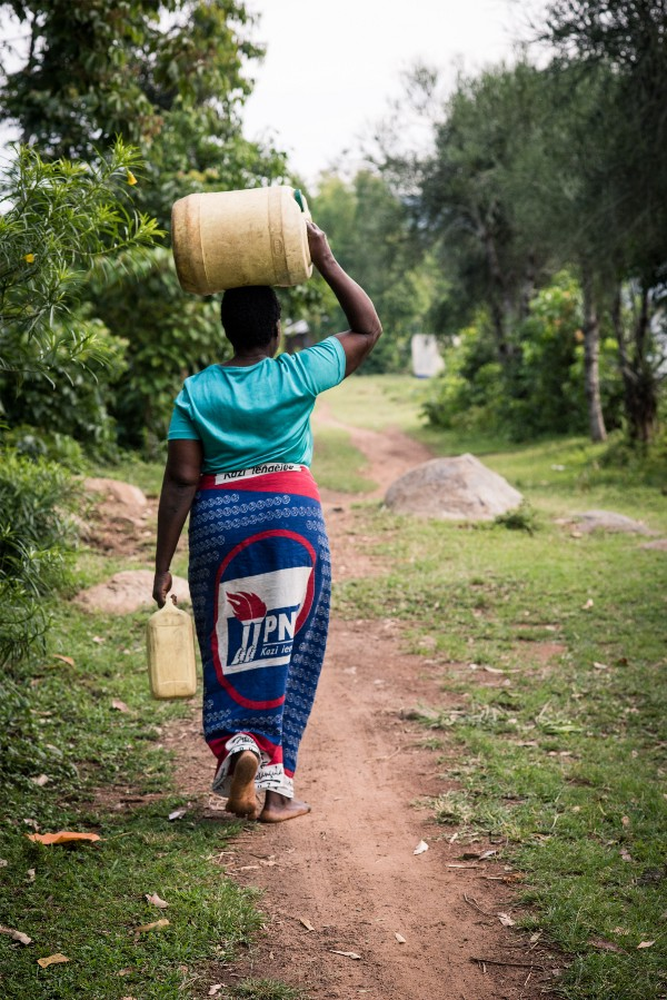 Kenyan farmer Christine Nakhumicha often starts her days walking up to 30 minutes from her home to gather the fresh water her family needs to cook, drink, and wash for the day.