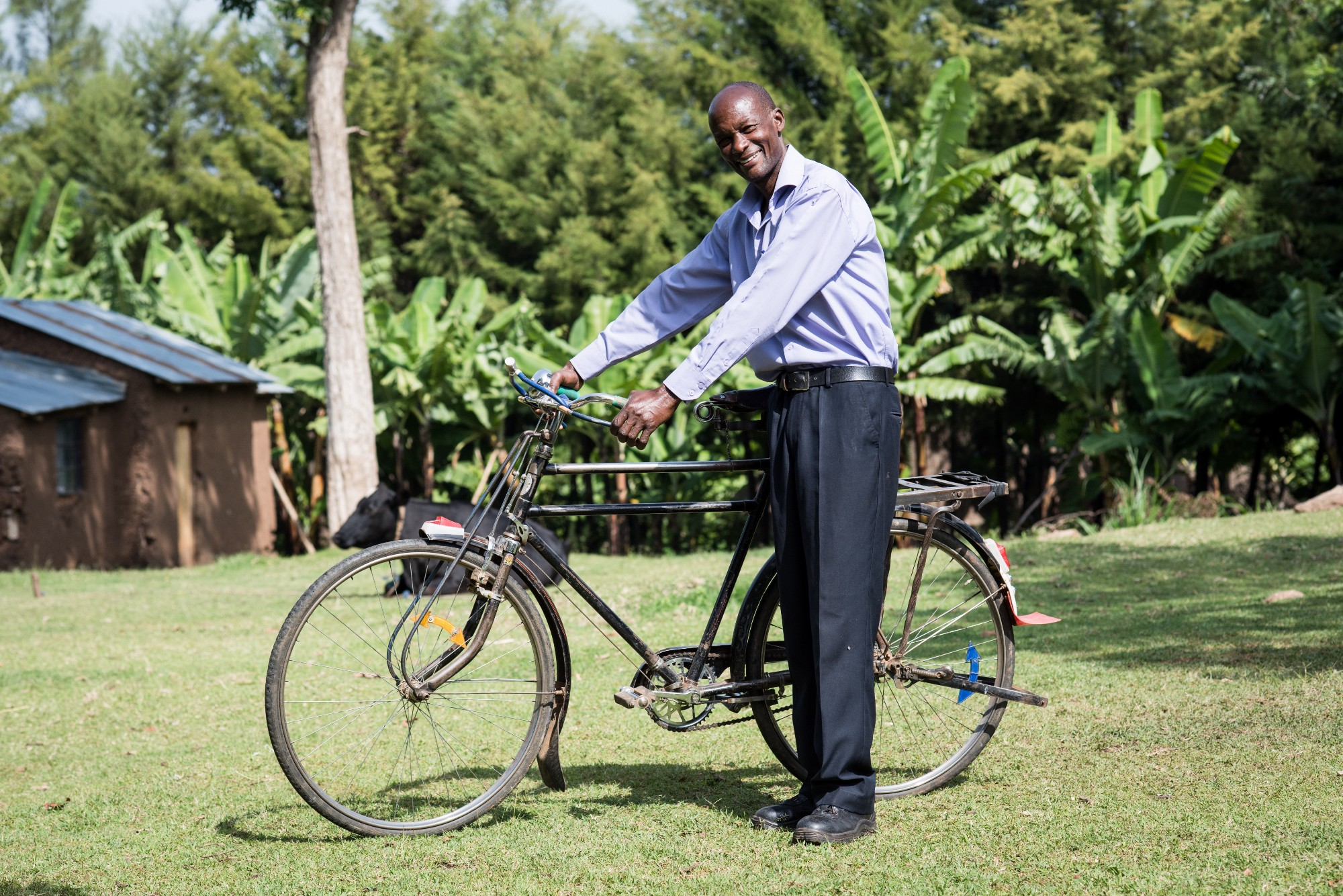 Outside of cities, everything from couches to 100-pound pigs can be seen being transported by bicycle. Above: Kenyan farmer Francis Mamati.