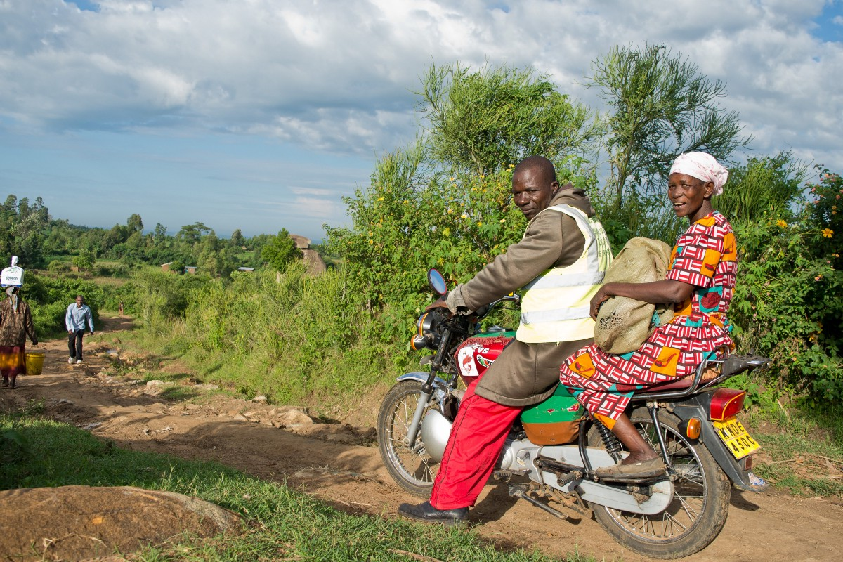 Juliana Wavomba embarking on her morning, hour-long motorbike taxi ride to her nearest market.