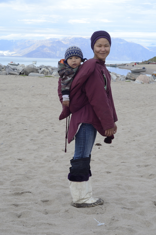 Woman wearing Amauti with child – Pond Inlet, Baffin Island
